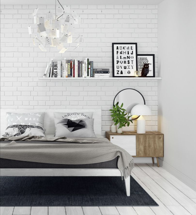 белая кирпичная кладка в спальной комнате
